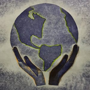 A pressure print created by a 7th grade student showing a pair of hands holding up the Earth.