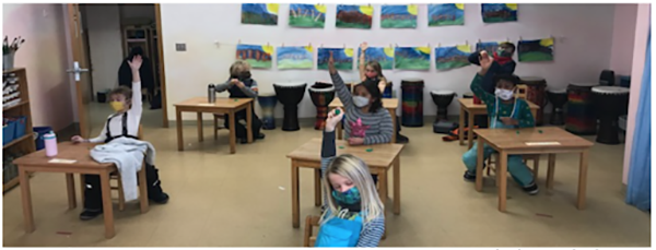 First grade students sit at desks in their classroom.