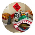 Dragon decorations and banners decorate Teacher Peng's home.