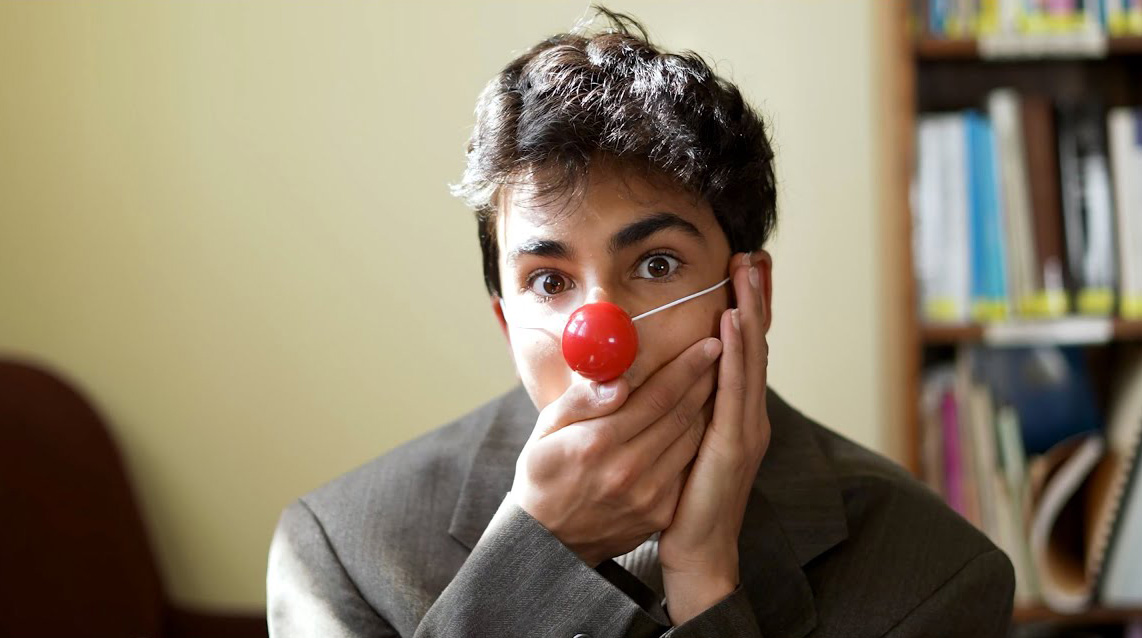 A CLWS 8th grade student poses with his clown nose on